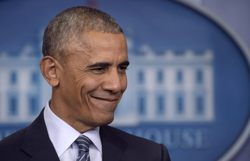 President Barack Obama smiles as he is asked a question during a news conference in the Brady press briefing room at the White House in Washington, Monday, Nov. 14, 2016. (AP Photo/Susan Walsh)