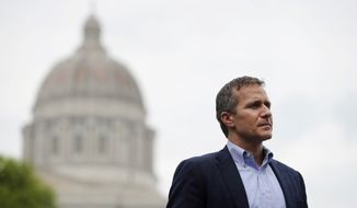 In this May 17, 2018, photo, Missouri Gov. Eric Greitens stands off to the side before stepping up to the podium to deliver remarks to a small group of supporters near the capitol announcing the release of funds for the state's biodiesel program in Jefferson City, Mo. A St. Louis judge on Monday appointed the prosecutor in Jackson County as the special prosecutor who will decide whether to refile an invasion-of-privacy case against Greitens. (AP Photo/Jeff Roberson)