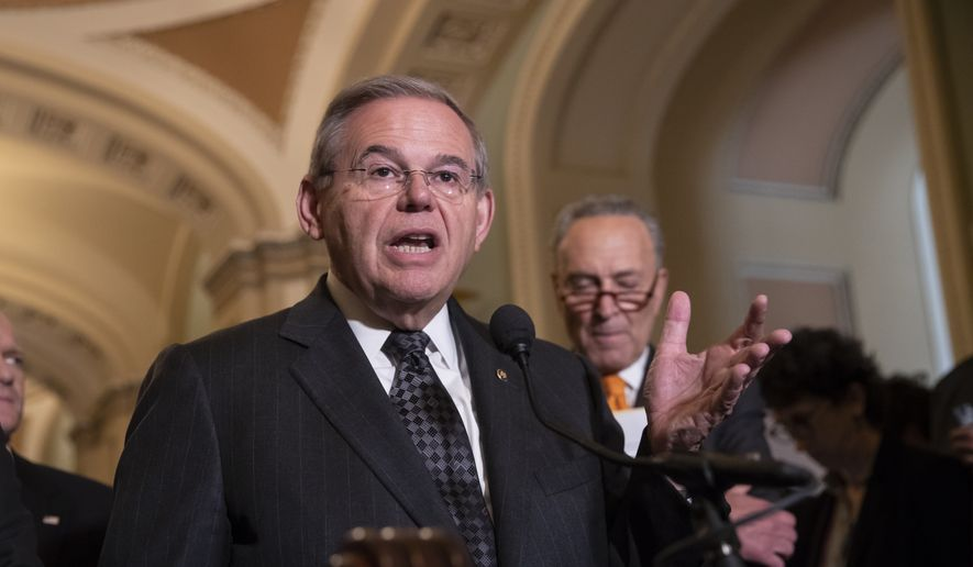 Sen. Bob Menendez, D-N.J., the ranking member of the Senate Foreign Relations Committee, joined at right by Senate Minority Leader Chuck Schumer, D-N.Y., talks to reporters on Capitol Hill in Washington, Tuesday, June 12, 2018. (AP Photo/J. Scott Applewhite) ** FILE **