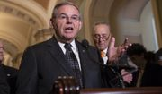 Sen. Bob Menendez, D-N.J., the ranking member of the Senate Foreign Relations Committee, joined at right by Senate Minority Leader Chuck Schumer, D-N.Y., talks to reporters on Capitol Hill in Washington, Tuesday, June 12, 2018. Republican and Democratic leaders aren't quite celebrating President Donald Trump's historic meeting Tuesday with North Korea's Kim Jong Un, saying the initial agreement they struck won't mean much unless the North completely denuclearizes. (AP Photo/J. Scott Applewhite)