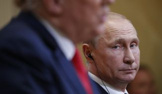 Russian President Vladimir Putin, right, looks over towards U.S. President Donald Trump, left, as Trump speaks during their joint news conference at the Presidential Palace in Helsinki, Finland, Monday, July 16, 2018. (AP Photo/Pablo Martinez Monsivais)