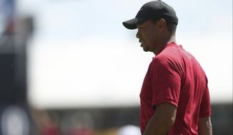 Tiger Woods of the US on the practice green during the final round of the British Open Golf Championship in Carnoustie, Scotland, Sunday July 22, 2018. (AP Photo/Jon Super)