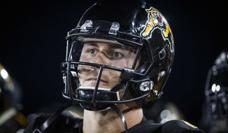 FILE - In this Thursday, July 19, 2018, file photo, Hamilton Tiger-Cats quarterback Johnny Manziel looks on from the sideline during second-half CFL football game action against the Saskatchewan Roughriders in Hamilton, Ontario. Manziel is headed to the Montreal Alouettes. Montreal acquired the former Heisman Trophy winner and offensive linemen Tony Washington and Landon Rice from the Hamilton Tiger-Cats for defensive end Jamaal Westerman, wide receiver Chris Williams and first-round draft picks in 2020 and 2021. (Mark Blinch/The Canadian Press via AP, File)