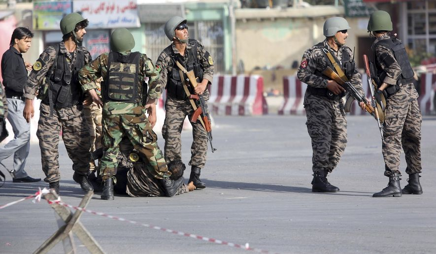 Afghan security personnel arrive to the site of an attack near the Kabul Airport, in Kabul, Afghanistan, Sunday, July 22, 2018. An Afghan spokesman says there has been a large explosion near the Kabul airport shortly after the country's controversial first vice president landed on his return from abroad. Gen. Abdul Rashid Dostum and members of his entourage were unharmed in the explosion on Sunday, which took place as his convoy had already left the airport (AP Photo/Rahmat Gul)