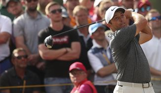 Francesco Molinari of Italy plays a shot off the 14th tee during the final round of the British Open Golf Championship in Carnoustie, Scotland, Sunday July 22, 2018. (AP Photo/Jon Super)