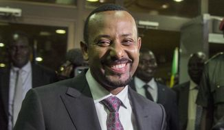 "FILE - In this Wednesday, June 20, 2018, file photo, Ethiopia's Prime Minister Abiy Ahmed, in Addis Ababa, Ethiopia.  Fitsum Arega the chief of staff for Prime Minister Ahmed, announced on Twitter, Sunday July 22, 2018, that Ahmed says the country has ""no option"" but to pursue multi-party democracy in the latest shakeup in a country ruled for decades by a single coalition.(AP Photo/Mulugeta Ayene, File)"