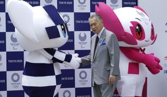 "Tokyo 2020 Olympic mascot ""Miraitowa"", left, and Paralympic mascot ""Someity"", right, and Tokyo Olympic organizing committee President Yoshiro Mori, attend at stage during their debut event in Tokyo Sunday, July 22, 2018. The official mascots for the Tokyo 2020 Olympics and Paralympics were unveiled at a ceremony on Sunday. The two mascot designs were selected by elementary schoolchildren across Japan. (AP Photo/Eugene Hoshiko)"