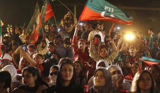 Supporters of Tehreek-e-Insaf party greet to their leader Imran Khan during an election campaign rally in Islamabad, Pakistan, Saturday, July 21, 2018. Pakistan will hold general election on July 25. (AP Photo/Anjum Naveed)