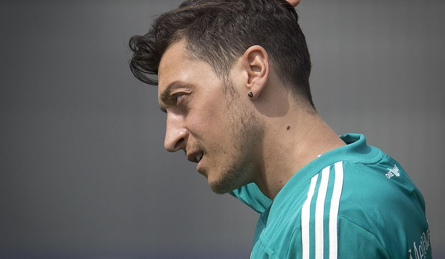 FILE - In this June 14, 2018 file photo Mesut Ozil scratches his head during a training session of the German team at the 2018 soccer World Cup in Vatutinki near Moscow, Russia. (AP Photo/Michael Probst, file)
