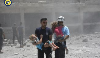 FILE - In this Wednesday, June 14, 2017, file photo, provided by the Syrian Civil Defense group known as the White Helmets, shows civil defense workers carrying children after airstrikes hit a school housing a number of displaced people, in the western part of the southern Daraa province of Syria. The Israeli military said Sunday it had rescued members of a Syrian volunteer civil organization, known as White Helmets, from the volatile frontier area and evacuated them to a third country, the first such Israeli intervention in Syria's lengthy civil war. (Syrian Civil Defense White Helmets via AP, File)