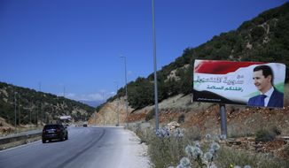 "In this Friday, July 20, 2018, photo, a poster of President Bashar Assad with Arabic that reads ""Welcome in victorious Syria."" is seen on the border between Lebanon and Syria Syria. The celebratory mood in government-controlled areas stems from successive military advances in the past year and an impression that President Bashar Assad, with massive support by unwavering allies Russia and Iran, has won the war or at least militarily defeated the opposition trying to topple him.(AP Photo/Hassan Ammar)"