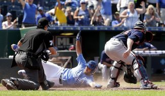 Kansas City Royals' Drew Butera (9) beats the tag at home by Minnesota Twins catcher Mitch Garver after hitting a three-run inside-the-park home run during the seventh inning of a baseball game Sunday, July 22, 2018, in Kansas City, Mo. (AP Phot0/Charlie Riedel)