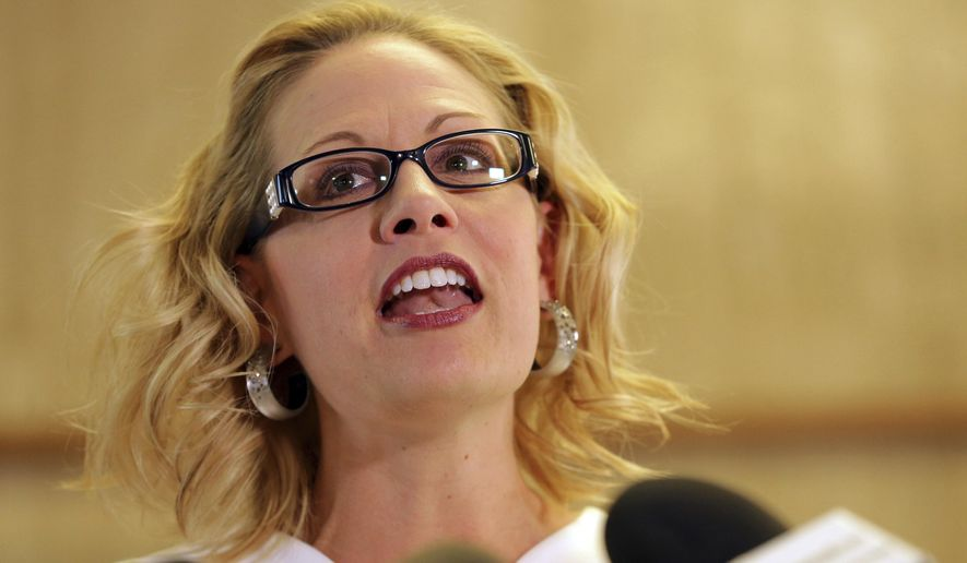Rep. Kyrsten Sinema, D-Ariz. speaks on May 29, 2018, at the Capitol in Phoenix. Sinema has come a long way from her days as a green party activist as she seeks to become the first Democrat to represent Arizona in the Senate in 30 years. (AP Photo/Matt York)