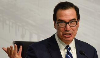 """""""I helped develop these economic issues,"""" Treasury Secretary Steven Mnuchin said on Monday. """"From my first meeting at the G-20 ... I've tried to emphasize that this is about making sure that we have free and fair, two-way trade."""" (ASSOCIATED PRESS)"""