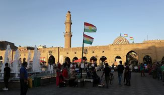 In this Saturday, Oct. 21, 2017, file photo, Kurdish flags wave in central Irbil, 217 miles (350 kilometers) north of Baghdad, Iraq. (AP Photo/Khalid Mohammed) ** FILE **