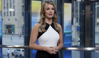 """Jillian Mele, co-host of Fox News Channel's Fox & Friends First, reports on the latest news headlines on the """"Fox & friends"""" television program, in New York Thursday, May 24, 2018. (AP Photo/Richard Drew)"""