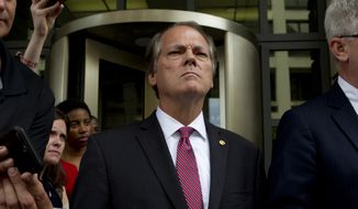 James Wolfe former director of security with the Senate Intelligence Committee leaves the federal courthouse, Wednesday, June 13, 2018, in Washington. James Wolfe a former director of security of the Senate Intelligence Committee was indicted for allegedly lying to FBI agents in December last year about repeated contacts with three reporters, which included the use of encrypted messaging applications. (AP Photo/Jose Luis Magana)