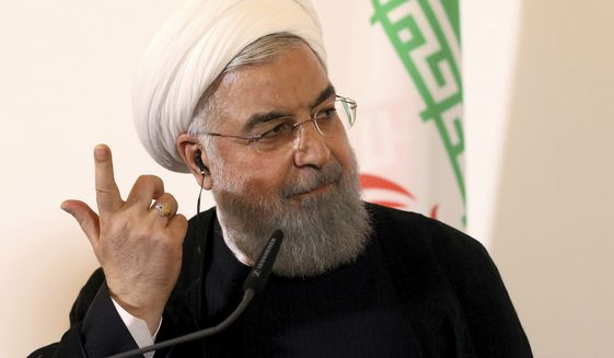 Iranian President Hassan Rouhani speaks during a joint news conference as part of a meeting with Austria's Chancellor Sebastian Kurz at the federal chancellery in Vienna, Austria, Wednesday, July 4, 2018. (AP Photo/Ronald Zak) **FILE**