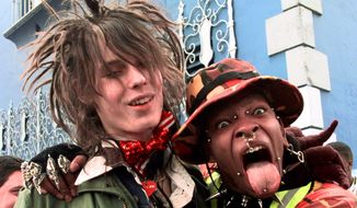 Ryoga Vee, 19, of Oklahoma, sticks his pearced tongue out for a picture with Music Television video jockey Jesse Camp during MTV's search for its newest on-air VJ at the Palace in the Hollywood section of Los Angeles, Tuesday, April, 6, 1999.  (AP Photo/Nick Ut)