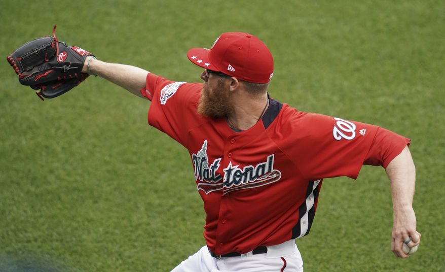 Washington Nationals pitcher Sean Doolittle warms up ahead of the 89th MLB baseball All-Star Game, Tuesday, July 17, 2018, at Nationals Park, in Washington. (AP Photo/Carolyn Kaster) ** FILE **