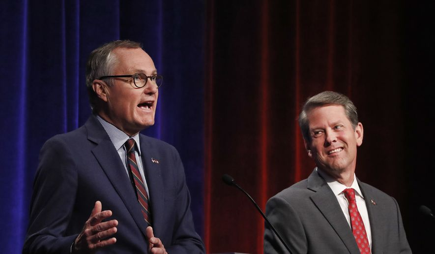 In this July 12, 2018, photo, Republican candidates for Georgia governor's race Georgia Lt. Gov. Casey Cagle, left, and Secretary of State Brian Kemp speak during an Atlanta Press Club debate at Georgia Public Television in Atlanta. The two will face each other July 24 in a runoff election for the Republican nomination. (AP Photo/John Bazemore)