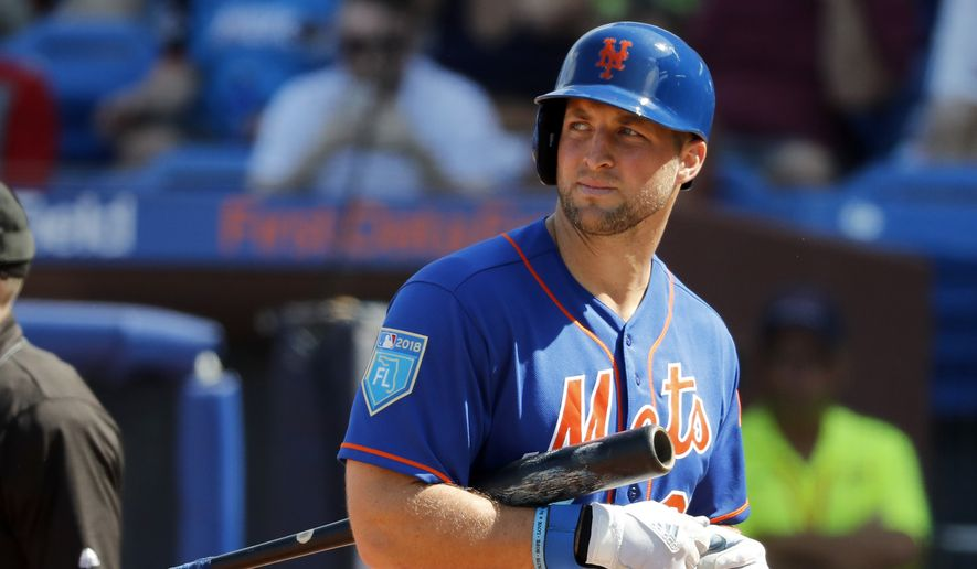 In this March 2, 2018, file photo, New York Mets' Tim Tebow walks back to the dugout after striking out during the second inning of an exhibition spring training baseball game against the Washington Nationals, in Port St. Lucie, Fla. (AP Photo/Jeff Roberson, File) **FILE**