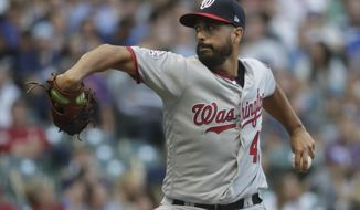 Washington Nationals starting pitcher Gio Gonzalez throws during the first inning of a baseball game against the Milwaukee Brewers Monday, July 23, 2018, in Milwaukee. (AP Photo/Morry Gash)