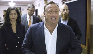 "In this April 17, 2017, file photo, ""Infowars"" host Alex Jones arrives at the Travis County Courthouse in Austin, Texas. (Tamir Kalifa/Austin American-Statesman via AP, File)"