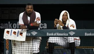 Baltimore Orioles center fielder Adam Jones, left, and second baseman Jonathan Schoop sit in the dugout in the ninth inning of a baseball game against the Boston Red Sox, Monday, July 23, 2018, in Baltimore. Boston won 5-3. (AP Photo/Patrick Semansky) **FILE**