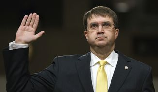In a Wednesday, June 27, 2018 file photo, Veterans Affairs Secretary nominee Robert Wilkie is sworn in at the start of a Senate Veterans Affairs Committee nominations hearing on Capitol Hill in Washington. Wilkie is expected to become secretary of Veterans Affairs when the Senate votes Monday, July 23, to confirm him. (AP Photo/Carolyn Kaster, File)