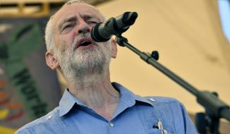 Britain's opposition Labour Party leader Jeremy Corbyn speaks at the Tolpuddle Martyrs Festival in Tolpuddle, England, Sunday July 22, 2018.  The Tolpuddle Martyrs were a group of agricultural labourers who clashed with authorities in 19th-century England. (Ben Birchall/PA via AP)