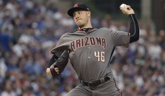Arizona Diamondbacks starting pitcher Patrick Corbin delivers during the first inning of a baseball game against the Chicago Cubs Monday, July 23, 2018, in Chicago. (AP Photo/Charles Rex Arbogast)