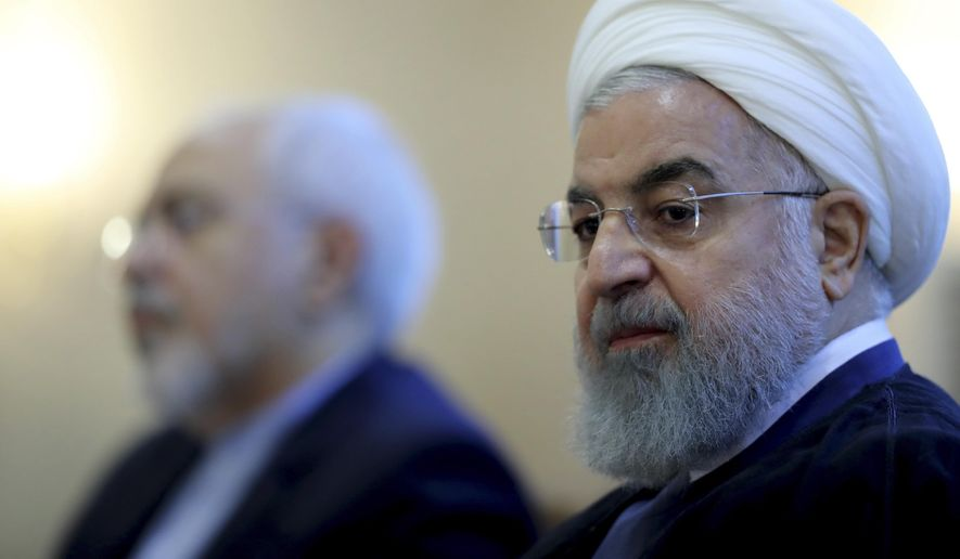 In this photo released by official website of the office of the Iranian Presidency, President Hassan Rouhani attends a meeting with a group of foreign ministry officials in Tehran, Iran, Sunday, July 22, 2018. Rouhani warned President Donald Trump against provoking his country while indicating peace between the two nations might still be possible. (Iranian Presidency Office via AP) **FILE**