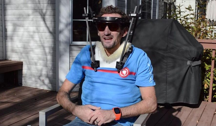 """This November 2017 image provided by On shows Tim Don outside his home in Boulder Colo. A few days before the 2017 Ironman world championships in Hawaii, British-born triathlete Tim Don was out on a training ride when he got hit by a truck. For three months, the 40-year-old world-record holder wore a halo to stabilize his broken neck. Nicknamed """"The Don,"""" his mission is straightforward: Get back to Hawaii and finish what he started. (Frank Vetterott/On via AP)"""