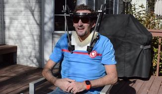 "This November 2017 image provided by On shows Tim Don outside his home in Boulder Colo. A few days before the 2017 Ironman world championships in Hawaii, British-born triathlete Tim Don was out on a training ride when he got hit by a truck. For three months, the 40-year-old world-record holder wore a halo to stabilize his broken neck. Nicknamed ""The Don,"" his mission is straightforward: Get back to Hawaii and finish what he started. (Frank Vetterott/On via AP)"
