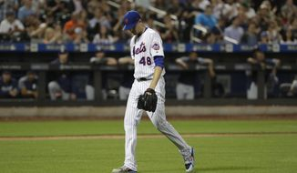 New York Mets starting pitcher Jacob deGrom (48) leaves the field after striking out San Diego Padres' Eric Hosmer during the eighth inning of a baseball game Monday, July 23, 2018, in New York. (AP Photo/Frank Franklin II)