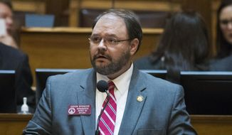 "In this Feb. 28, 2018, file photo, Rep. Jason Spencer, of Woodbine, speaks at the Georgia State Capitol in Atlanta. Spencer is seen using racial slurs and dropping his pants in an episode of Sacha Baron Cohen's Showtime series ""Who Is America?"".In the Sunday, July 22, broadcast, Spencer repeatedly uses a racial slur for African Americans and later exposes his bottom after being told it helps scare away Muslim terrorists. (Alyssa Pointer/Atlanta Journal-Constitution via AP)"