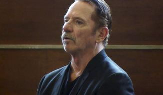 """FILE - In this Aug. 3, 2017 file frame from video, actor Tom Wopat stands during arraignment in Waltham, Mass., on indecent assault and battery and drug possession charges. The former star of """"The Dukes of Hazzard"""" television show pleaded guilty to inappropriately touching two women in the cast of a musical in Massachusetts in which he starred. Prosecutors said Wopat was sentenced Friday, July 20, 2018, to a year of probation. (WCVB-TV via AP, Pool, File)"""