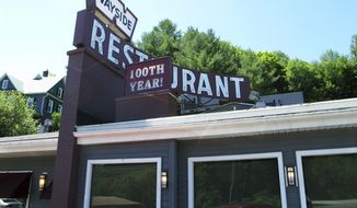 In this Thursday, July 19, 2018, photo, a sign over the Wayside Restaurant in Berlin, Vt., proclaims that the restaurant is celebrating 100 years in business this year. (AP Photo/Lisa Rathke)