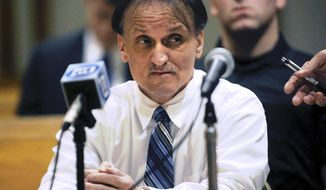 FILE - In this May 22, 2014 file photo, Richard Roszkowski listens to victims' statements during his sentencing at the Superior Courthouse in Bridgeport, Conn. The Connecticut Supreme Court is scheduled to decide Monday, July 23, 2018, whether to order a new murder trial for Roszkowski, convicted of gunning down two adults and a 9-year-old girl on a Bridgeport street in 2006. Roszkowski said he was mentally ill and that officials failed to order a competency exam. (Hearst Connecticut Media/Brian A. Pounds via AP, Pool, File)