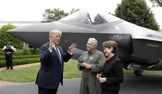 "President Donald Trump talks with Lockheed Martin president and CEO Marilyn Hewson and director and chief test pilot Alan Norman in front of a F-35 as he participates in a ""Made in America Product Showcase"" at the White House, Monday, July 23, 2018, in Washington. (AP Photo/Evan Vucci) ** FILE **"