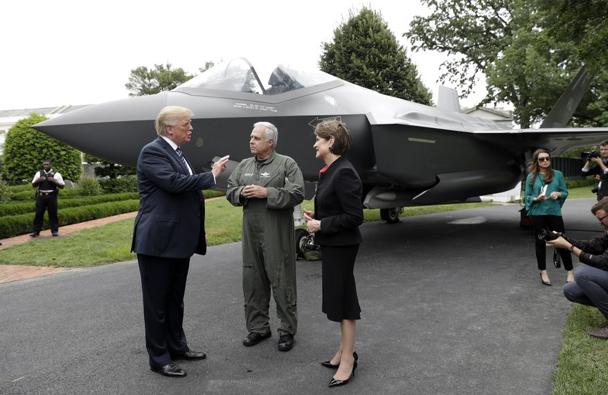 "In this July 23, 2018, file photo, President Donald Trump talks with Lockheed Martin president and CEO Marilyn Hewson and director and chief test pilot Alan Norman in front of a F-35 as he participates in a ""Made in America Product Showcase"" at the White House in Washington. On Oct. 28, 2019, the Pentagon and Lockheed Martin on completed a $34 billion deal that will result in the delivery of 478 F-35 Lightning II fighter jets. (AP Photo/Evan Vucci) **FILE**"