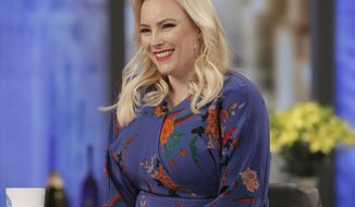 "This Feb. 28, 2018 photo released by ABC shows Meghan McCain on the set of ""The View,"" in New York.  McCain brings a feisty spirit to the conservative commentator role where predecessors frequently seemed overmatched and overlooked. She often reflects the views of President Trump's supporters at a table and city where they are deeply unpopular. (Lou Rocco/ABC via AP)"