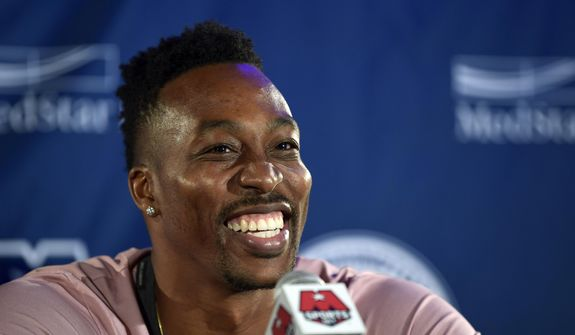 Washington Wizards recently acquired center Dwight Howard speaks during a news conference in Washington, Monday, July 23, 2018. Howard, an eight-time All-Star, averaged 16.6 points per game and 12.5 rebounds last season with the Charlotte Hornets. (AP Photo/Susan Walsh) ** FILE **