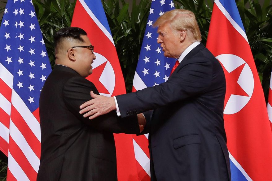In this Tuesday, June 12, 2018, photo, U.S. President Donald Trump shakes hands with North Korea leader Kim Jong-un at the Capella resort on Sentosa Island in Singapore. Mr. Trump has already met twice with Russian President Vladimir Putin, but he is eager to re-create in Finland the heady experience that he had last month with Mr. Jong-un. That Singapore summit became a mass media event complete with powerful presidential images. (AP Photo/Evan Vucci, File)
