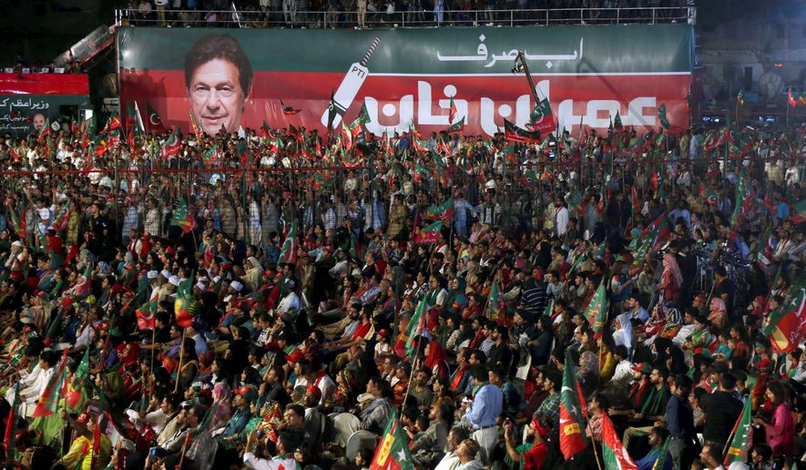 Supporters rallied for prime minister candidate Imran Khan this week as Pakistanis prepared to make history on Wednesday by electing a third consecutive civilian government. (Associated Press)