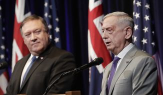 U.S. Secretary of Defense Jim Mattis, right, speaks next to U.S. Secretary of State Mike Pompeo at a 2018 Australia-U.S. Ministerial (AUSMIN) Consultations news conference in Stanford, Calif., Tuesday, July 24, 2018. (AP Photo/Jeff Chiu)