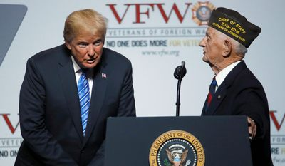 World War II veteran Allen Q. Jones asks a question of President Donald Trump at the Veteran's of Foreign Wars national convention Tuesday, July 24, 2018, in Kansas City, Mo. (AP Photo/Charlie Riedel)