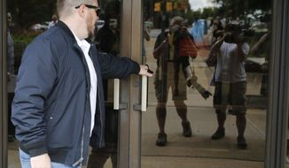 White Nationalist Jason Kessler arrives at Federal court 45 minutes late for a hearing on his rally permit in Charlottesville, Va., Tuesday, July 24, 2018. Kessler, an organizer of last summer's deadly white nationalist rally in Virginia, has withdrawn his request for a court order allowing him to stage an event marking the rally's anniversary. (AP Photo/Steve Helber)