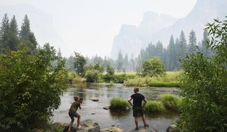 German tourists are shown in this July 24, 2018 file photo taken along the Merced River in Yosemite National Park  (Eric Paul Zamora/The Fresno Bee via AP) **FILE**
